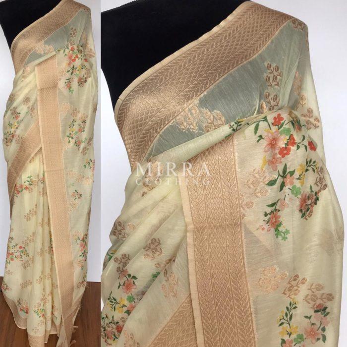 Cream Linen Silk Saree with Beautiful Prints along with Antique Zari Border