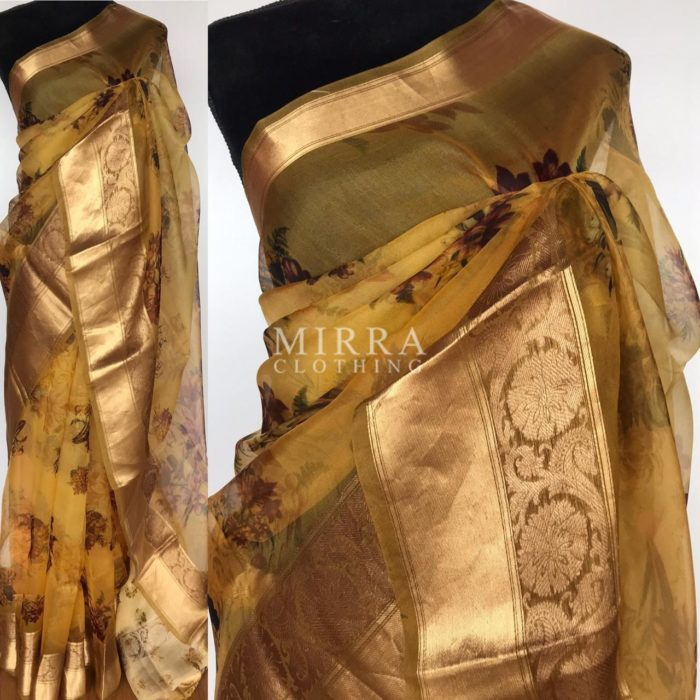 Yellow Pure Organza Saree with Beautiful Prints along with Kanchi Zari Border
