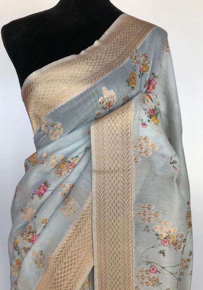 Ice Blue Linen Silk Saree with Beautiful Prints along with Antique Zari Border
