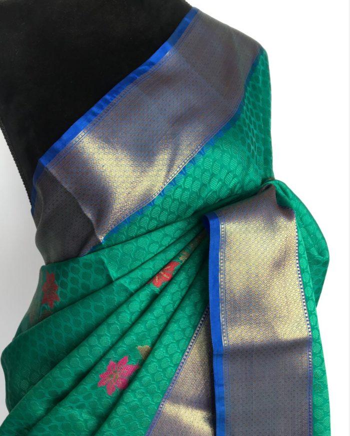 Teal Kora Silk Saree with woven floral motifs all over