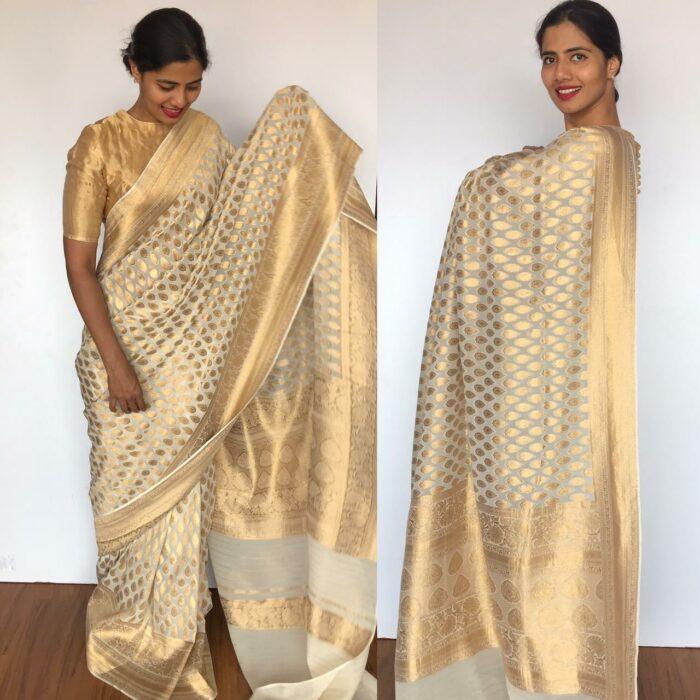Ivory Banarasi Silk Saree in Georgette adorned with Gold Zari Motifs