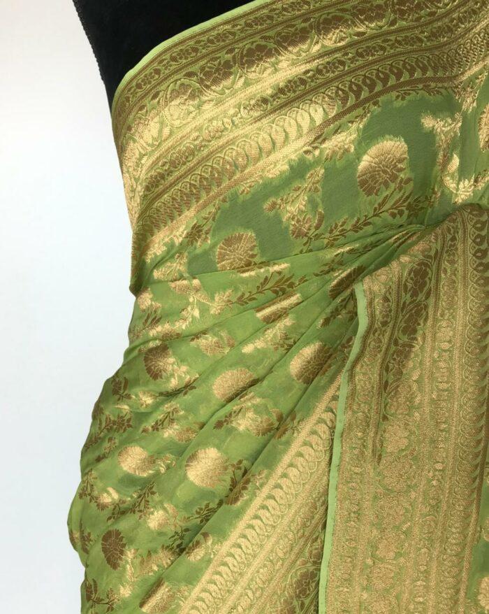 Sea Green Banarasi Silk Saree in Georgette adorned with Gold Zari Motifs