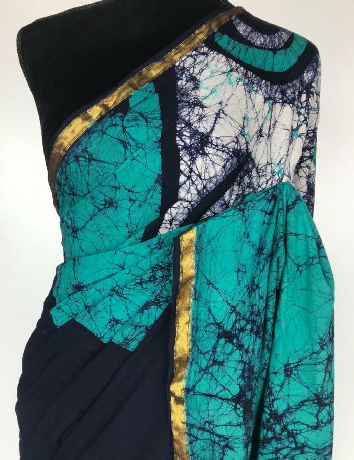 Blue Batik print Saree with Gold Zari Border