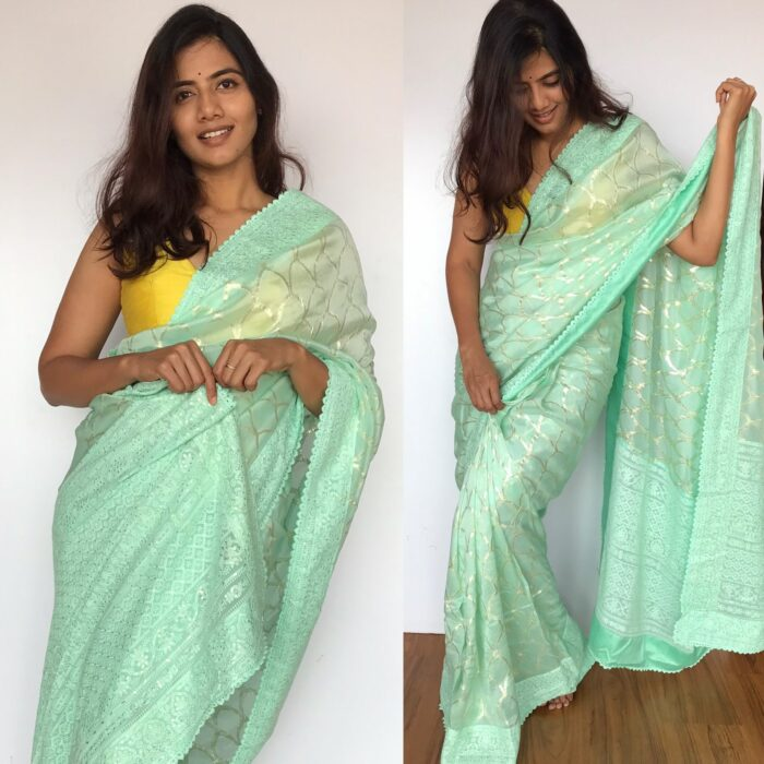 Mint Organza Saree with Silver Zari Weaves highlighted with Embroidered Border