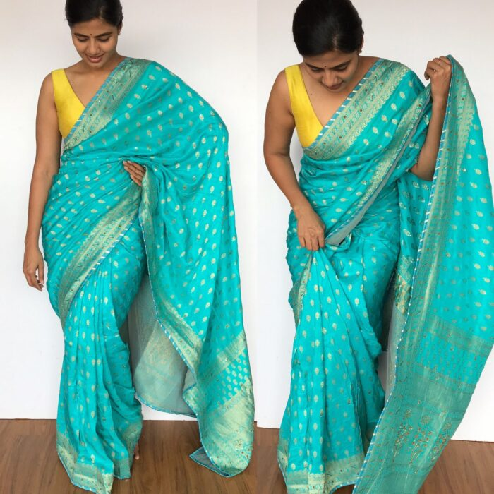 Blue Banarasi Silk Saree in Georgette with Gold Zari Weaves highlighted with Beautiful Zardozi Embroidery and Gota Piping