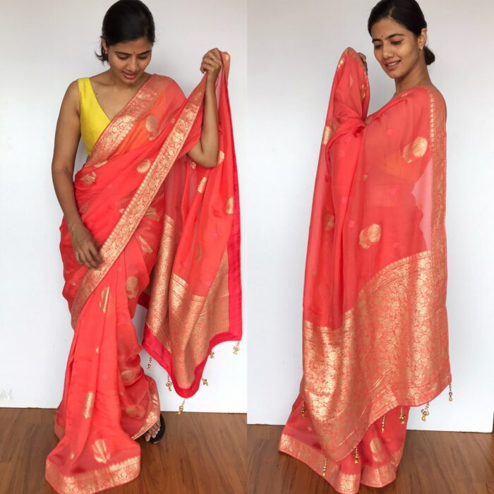 Peach Organza Saree with Gold Zari Weaves highlighted with Beautiful Gota Edging